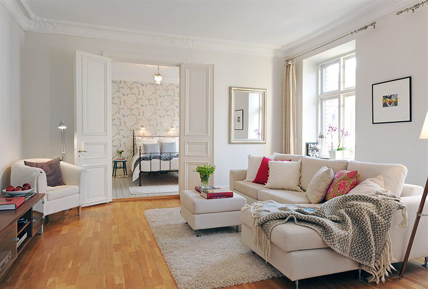 Gorgeous Swedish style living room with neutral romantic decor in Stockholm apartment