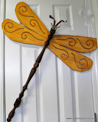 scroll design table leg dragonfly