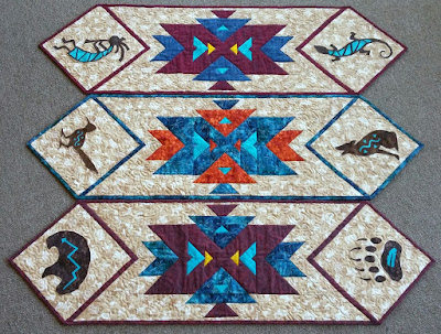 http://www.craftsy.com/pattern/quilting/home-decor/southwest-kokopelli-table-runner-pattern/174975