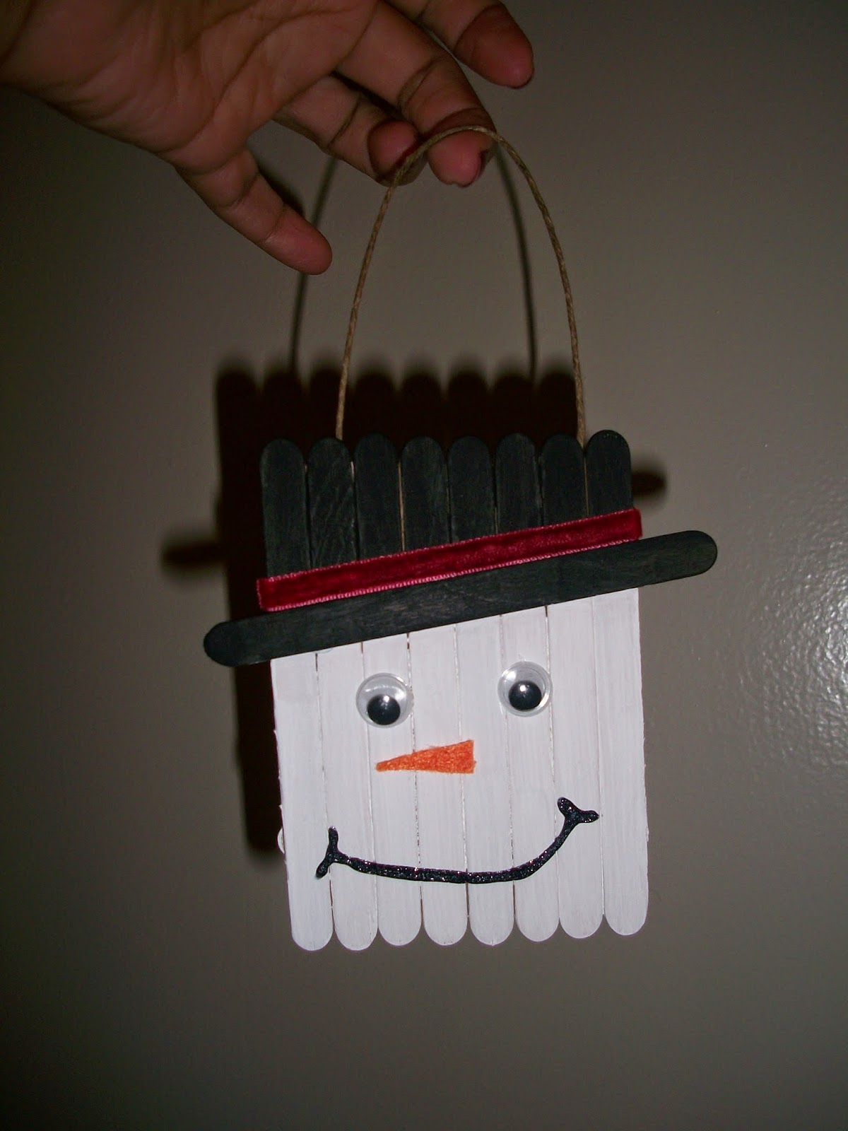 Completed DIY craft stick snowman ornament