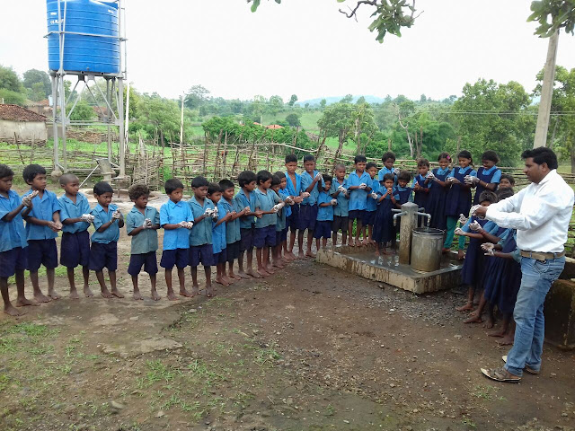 Local children learning about sanitation
