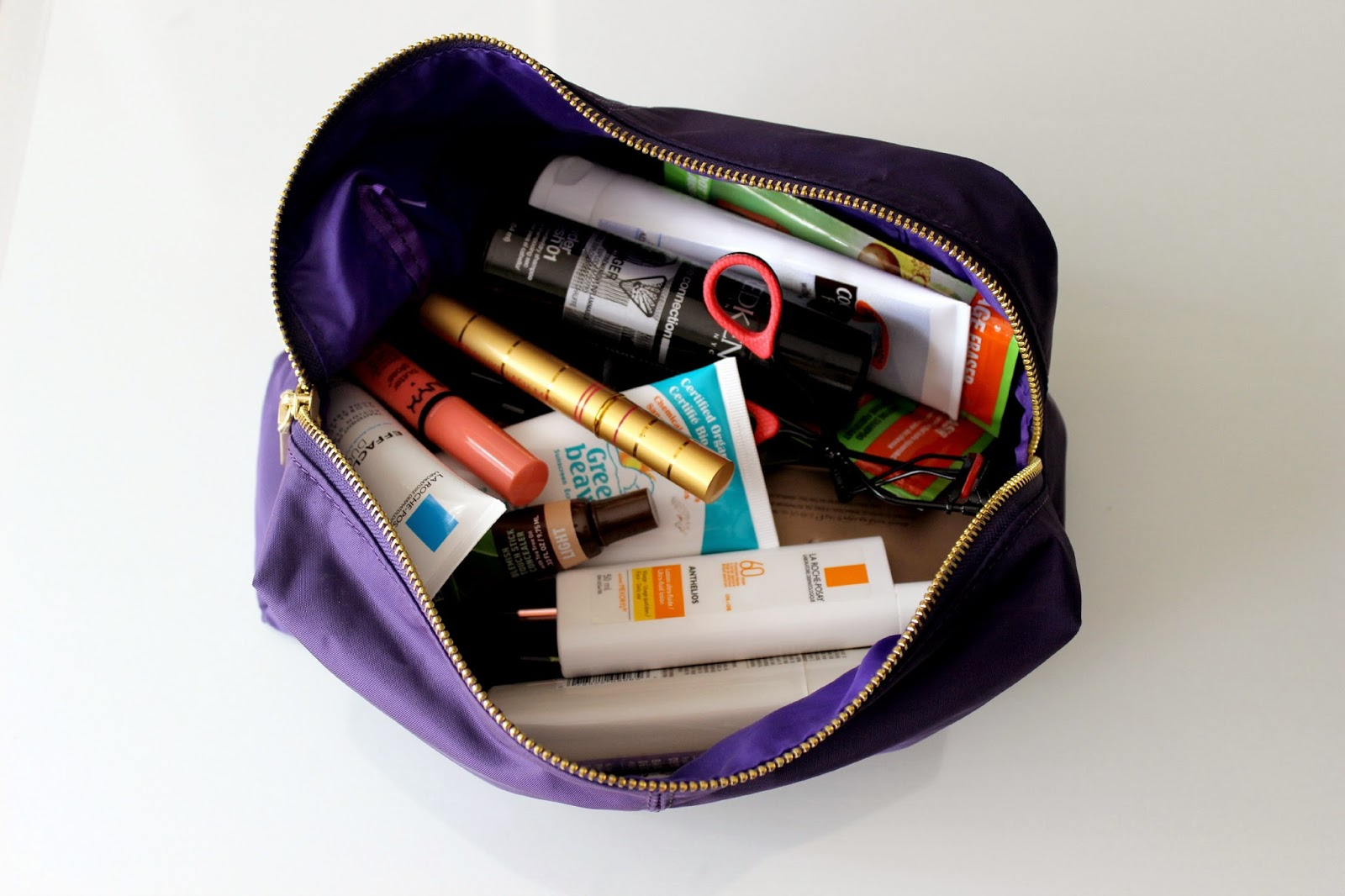 What S In My Travel Makeup Beauty Bag Natalie Loves Beauty