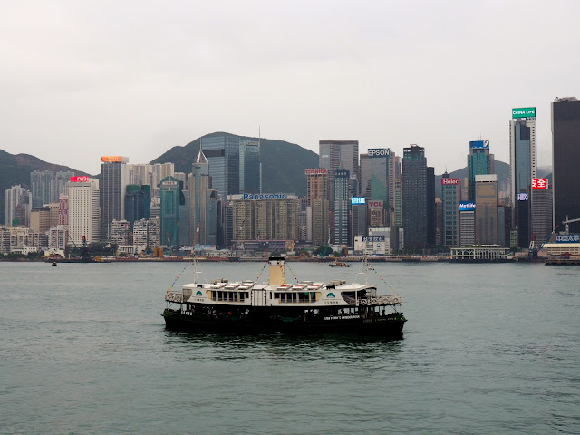View of Hong Kong island skyline & Star Ferries boat from TST, Kowloon