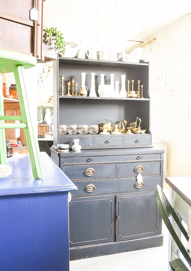 Painted and distressed black antique hutch
