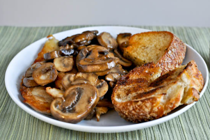 CARAMELIZED CHICKEN WITH MUSHROOM SAUCE AND GRILLED HERB BREAD.