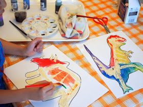 preschool STEM and art project- tape resist dinosaur watercolor paintings