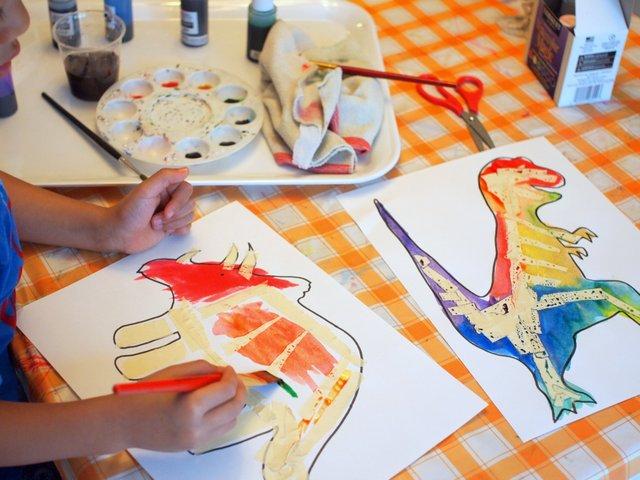 preschool STEM and art project- tape resist dinosaur watercolor paintings