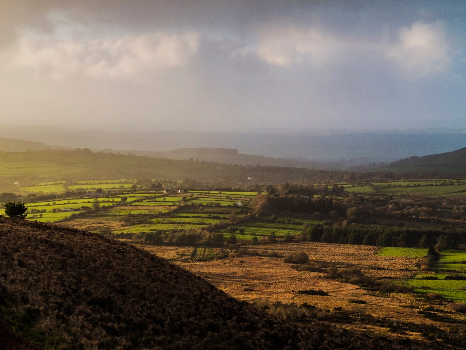 Hazy sunset landscape of a valley in North Cork.