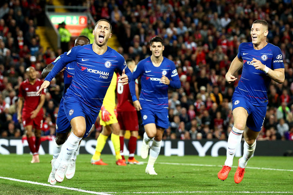 Eden hazard celebrates his beautiful solo goal as Chelsea beat Liverpool 2-1 at Anfield in the Carabao cup