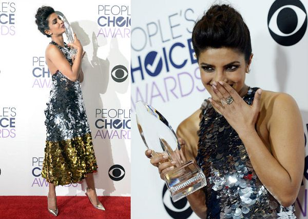 priyanka chopra KISSING THE trophy prize AND SMILING people's choice favorite actress in a new tv series quantico as alex parrish