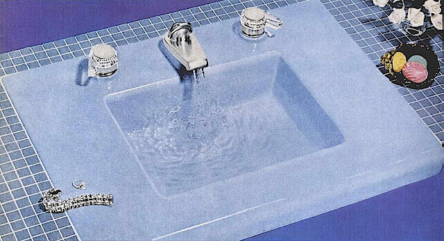 a blue 1957 bathroom sink photograph, radical design