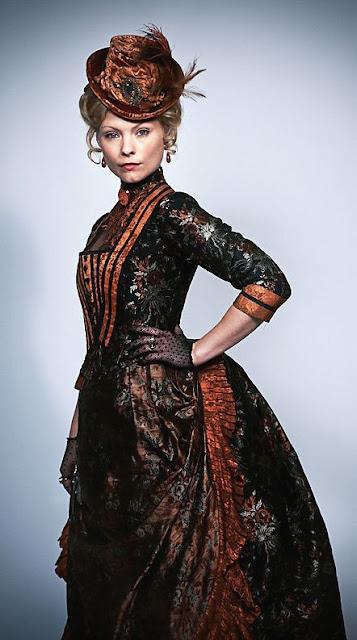 Women's Victorian Era Clothing. Orange hat, orange and brown bodice, matching skirt, lace gloves. Women's steampunk clothing.