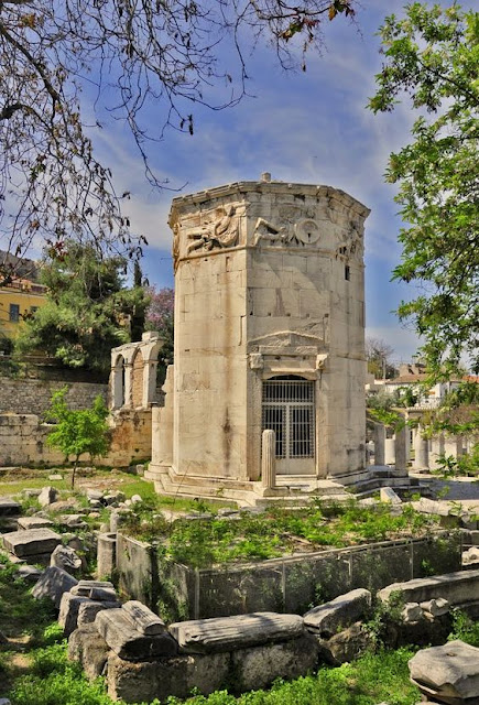 The Tower of the Winds, also called horologion (timepiece) is an octagonal Pentelic marble clock tower, located at the ancient agora, under the Acroplolis, Plaka, Athens.