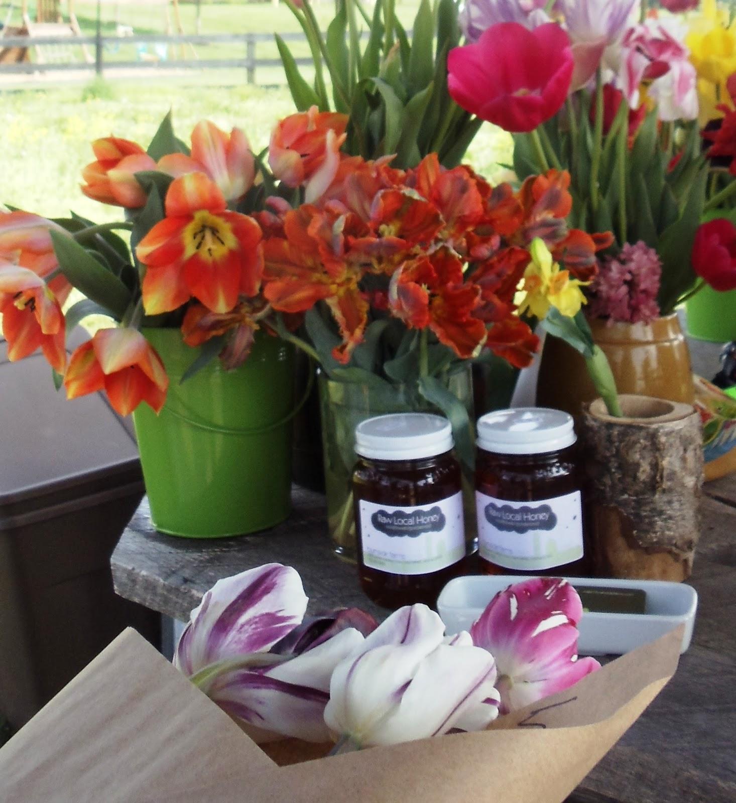 Tulips and jars of honey