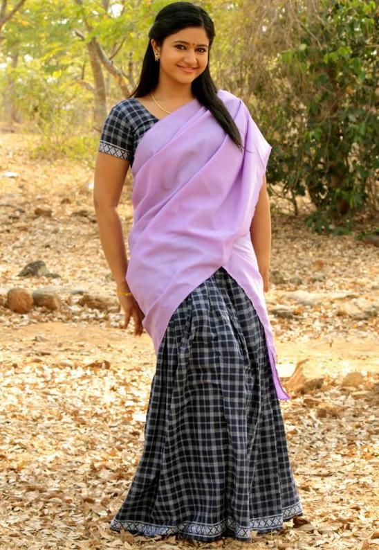 South Indian Chubby Actress Poonam Bajwa Hot Hip Navel Stills In Violet Half Saree