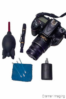 Cramer Imaging's photograph of a camera and camera cleaning kit on a white background
