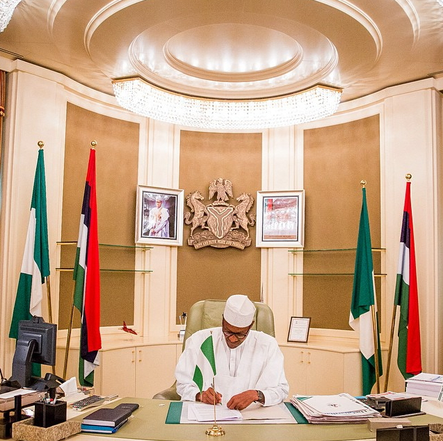 photos buhari resumes office at aso rock presidential