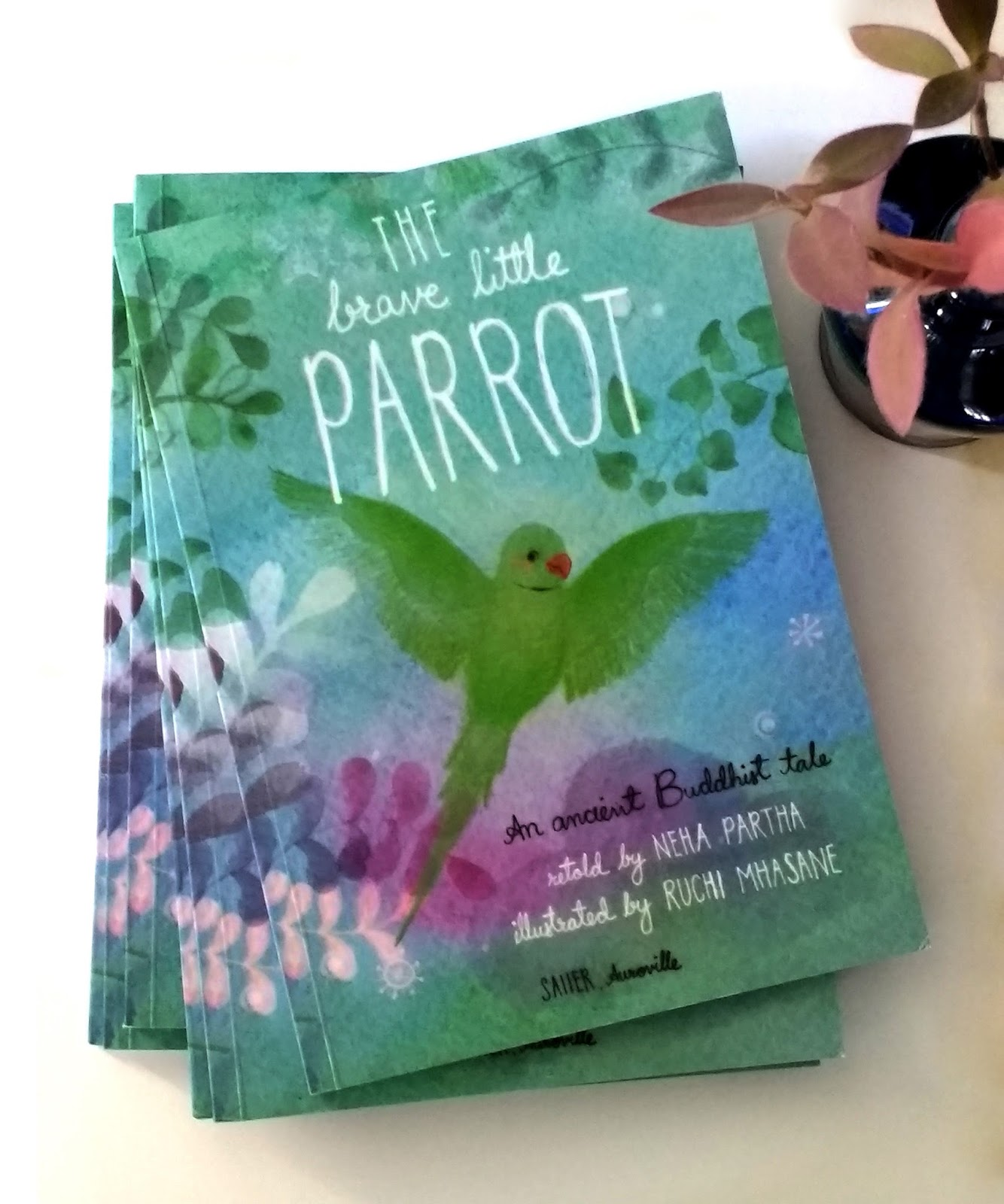 the brave little parrot Buddhist tale: tirelessly working to put out a fire that was harming the homes and lives of others, a small parrot is determined to make a difference.