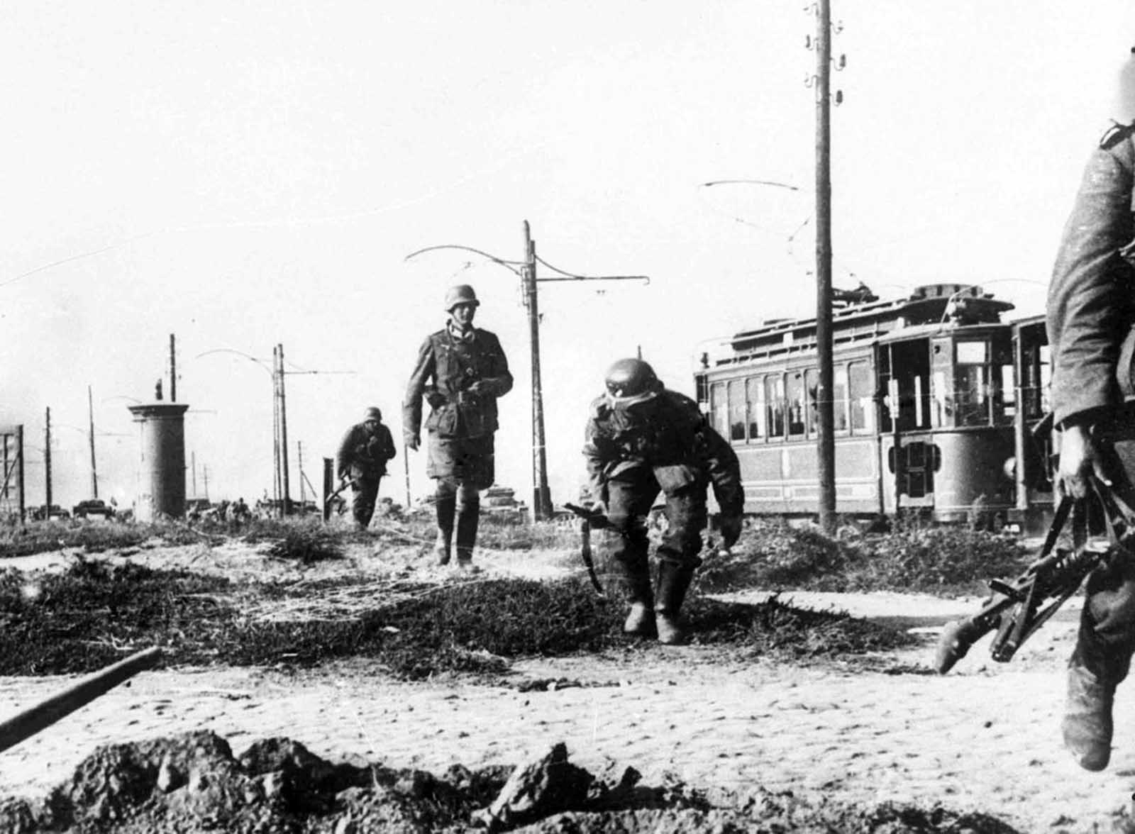German infantry cautiously advance on the outskirts of Warsaw, Poland on September 16, 1939.