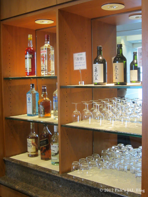 Self-served bar at JAL First Class Lounge at JFK Terminal 1