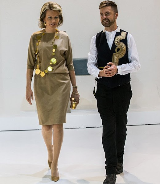 Queen Mathilde visited the 2016 Biennale Interieur Exhibition  at the Kortrijk Xpo in Kortrijk. Queen Mathilde wore Mattijs van Bergen dress, Natan necklace, DFV gold clutch bag
