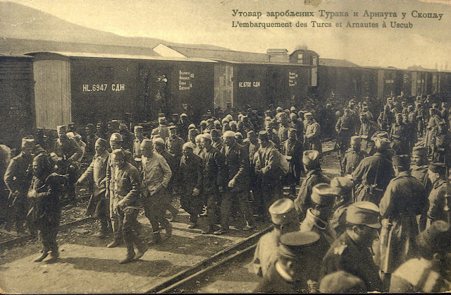 "Loading of Turkish and ""Arnaut"" (Albanian) soldiers on trains in Skopje during the First Balkan War (Serbian postcard)"
