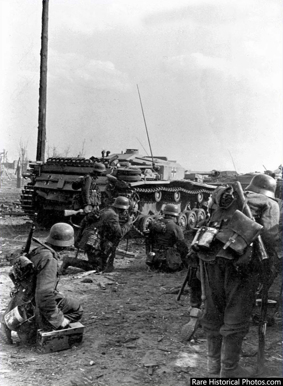 Germans prepare to attack in the outskirts of Stalingrad; taking cover behind a Stug 3.