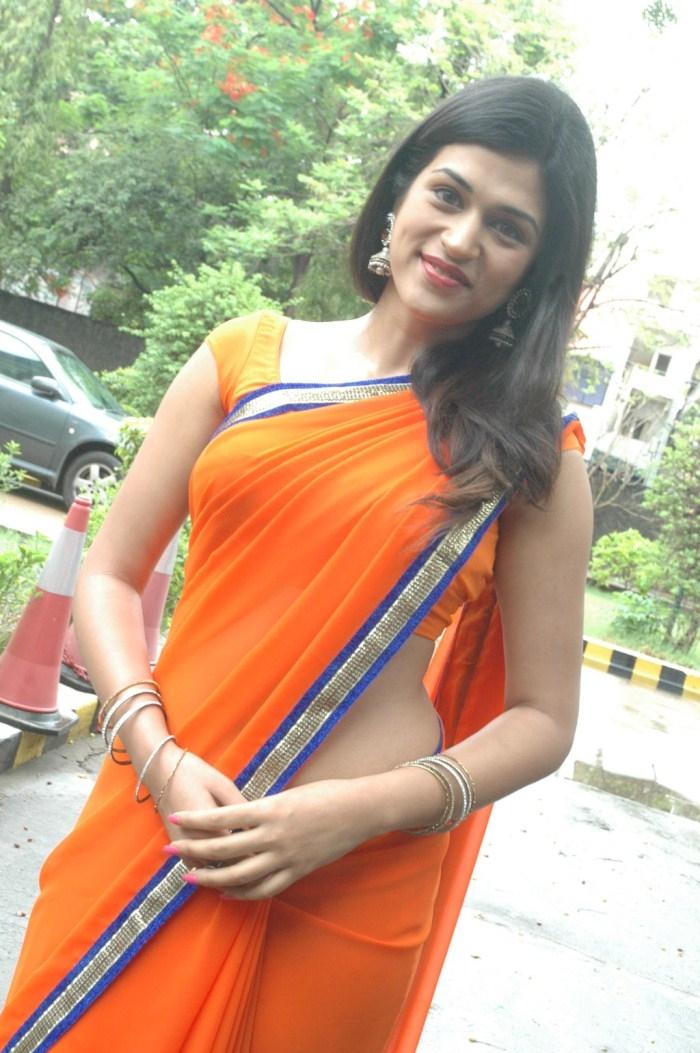 Shraddha Das Saree Black Orange
