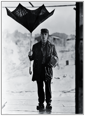 Buster Keaton Holding Broken Umbrella in Steamboat Bill, Jr. 1928