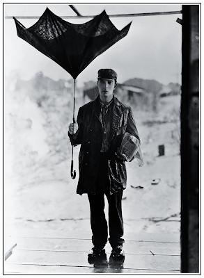 Buster Keaton Holding Broken Umbrella in Steamboat Bill, Jr. 1928