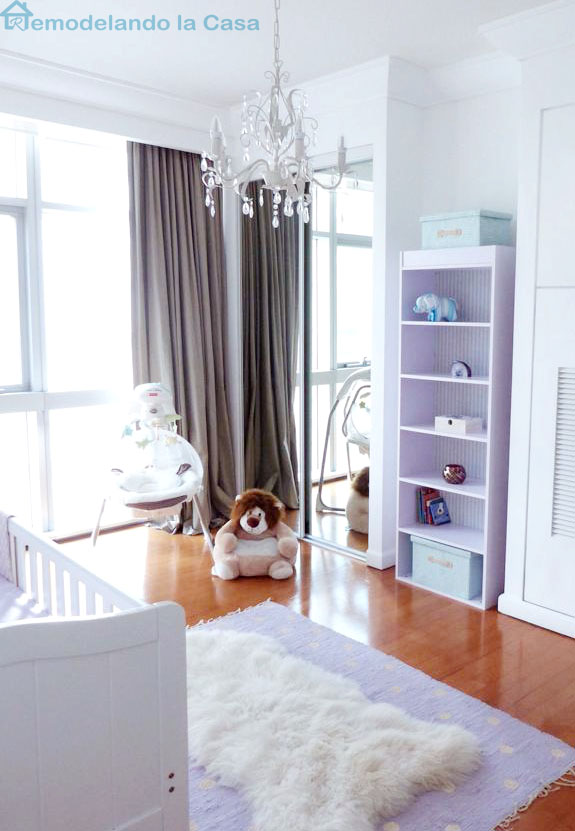 bookcase and toys inside girl nursery