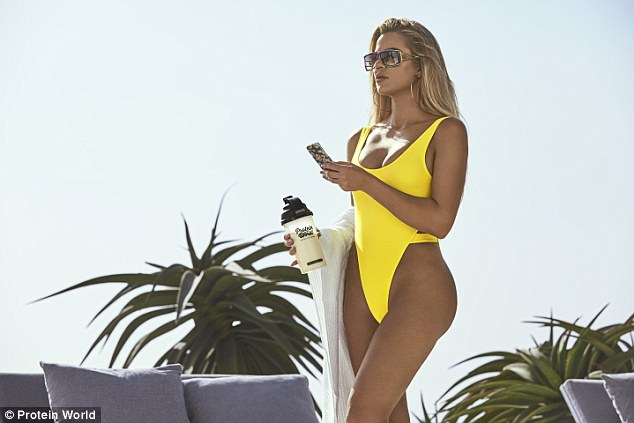 Khloe Kardashian flaunts banging bod in yellow swim suit