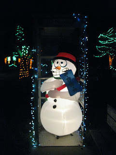 Lighted inflatable snowman in a phone booth, Vasona Lake County Park, Los Gatos, California