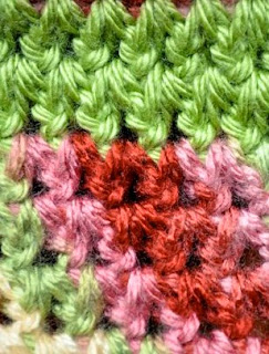 http://translate.google.es/translate?hl=es&sl=en&tl=es&u=http%3A%2F%2Fmymerrymessylife.com%2F2014%2F04%2Fcrochet-stitch-photo-tutorial-forked-half-double-crochet.html