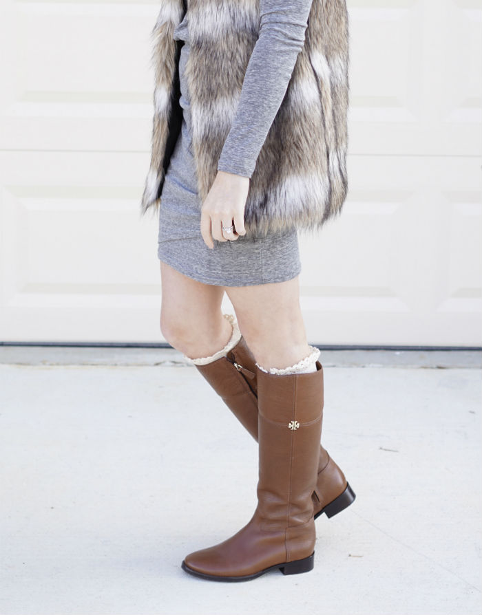 what to pair with a fur vest, styling fur, tory burch riding boots