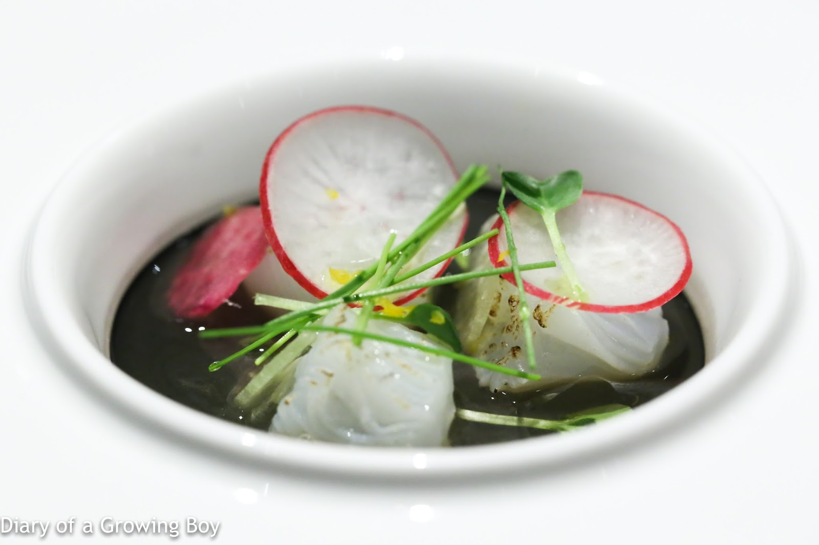 Black egg custard topped with aori squid and colorful radish - one of  Sato-san's signature dishes since his days at Tenku RyuGin (天空龍吟).