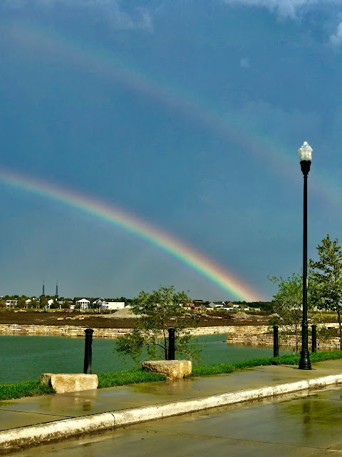 Rainbow over a lake and some houses