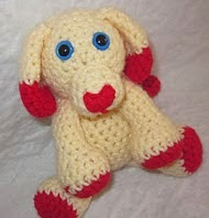 http://www.ravelry.com/patterns/library/mini-valentines-day-puppy