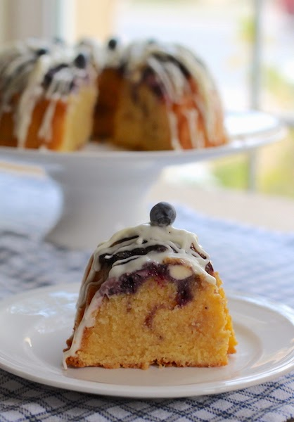 Food Lust People Love: This Lemon Blueberry Van Halen Bundt is a rich and buttery pound cake, filled with cream cheese and blueberries then drizzled with a lemon cream cheese glaze.