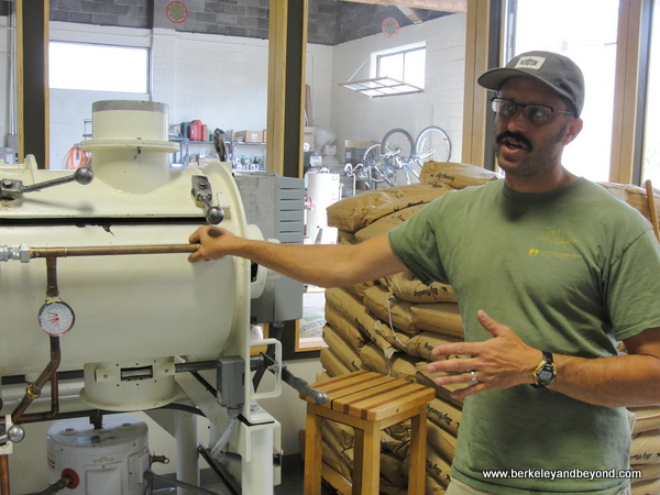 co-owner Adam Dick with grinding ball mill at Dick Taylor Craft Chocolate in Eureka, California