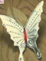 http://artes.uncomo.com/articulo/como-hacer-mariposas-con-latas-para-decorar-37314.html