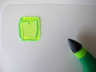 IDO3D pen drawing next to a plastic shape with an edge drawn on it.