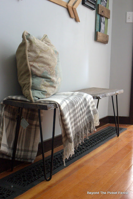 add vintage hairpin legs to a live edge reclaimed barnwood piece to make a coffee table or bench
