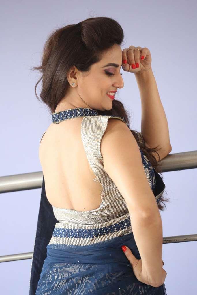 Glamorous Anchor Manjusha Back Show Images In Blue Saree