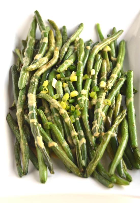 Roasted Dijon Green Beans are full of flavor, easy to make and the perfect healthy side dish for any meal. www.nutritionistreviews.com