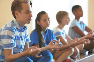 Yoga classes are becoming more prevalent in America's schools.