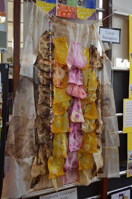 Cloak made from brown, yellow and pink wet wipes