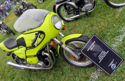 Bright yellow motorcycle with fairing.