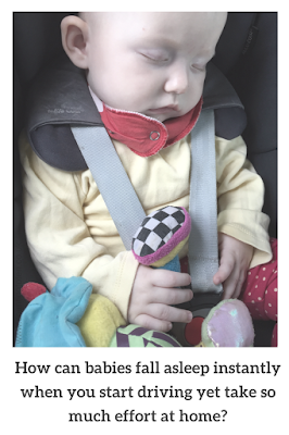 Photograph of a baby sleeping in a car seat