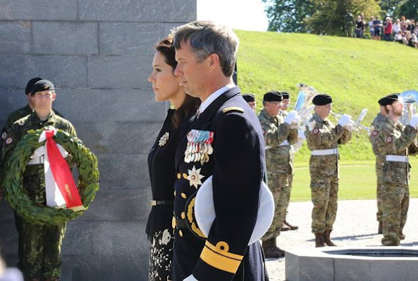 Crown Prince Frederik of Denmark and Crown Princess Mary of Denmark attended the traditional wreath-laying ceremony
